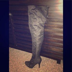 Thigh high Dollhouse black suede boots..